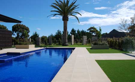 A paved pool and landscape garden in Mornington Peninsula, Victoria.