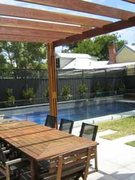 A paved outdoor entertaining area and pool in Sandringham, Victoria